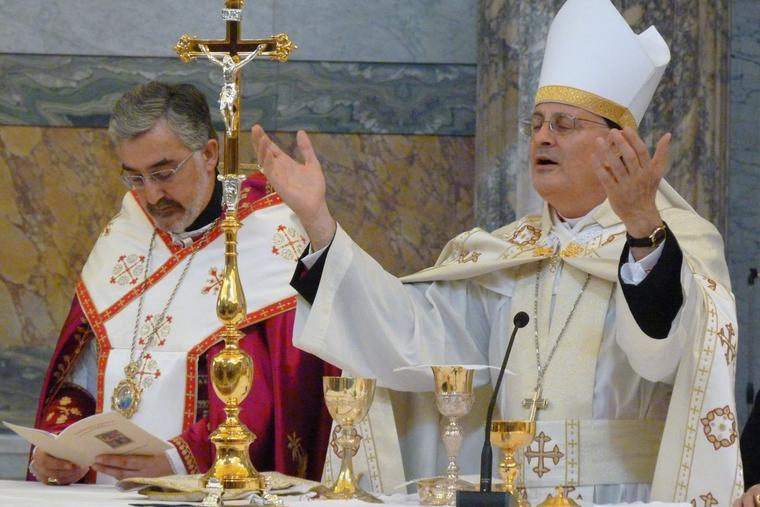 Above, Bishop Gregory John Mansour of the U.S. Maronite Catholic Church celebrates Mass in Rome, May 17, 2012. He and his fellow bishops are calling for aid to Lebanon and support of religious freedom there.
