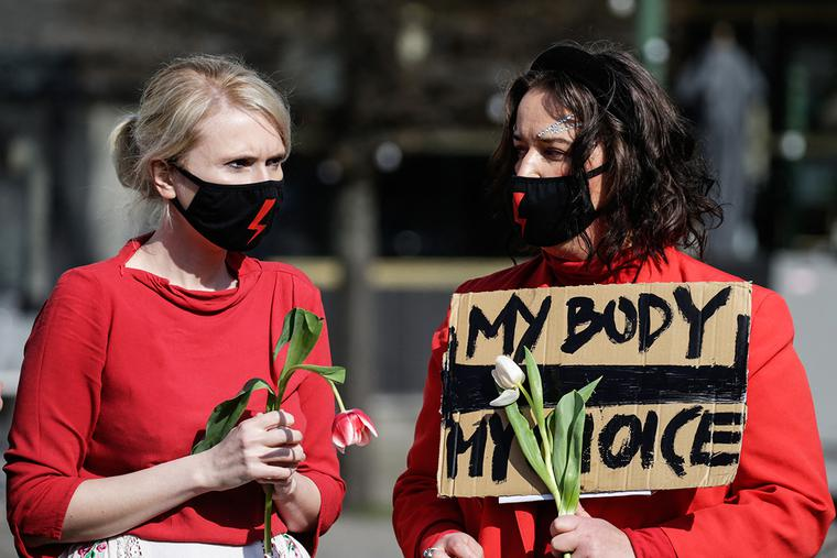 Women demonstrate in front of the European Parliament in Brussels March 8 to denounce, among others, the restrictions on access to abortion in Poland.