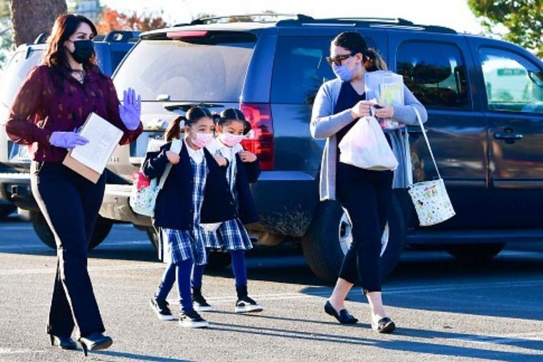 Students arrive at St. Joseph Catholic School in La Puente, California, on Nov. 16, 2020.