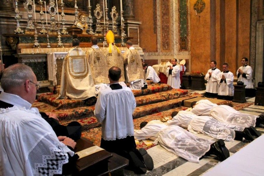 The prostration of the ordinands takes place during the Litany of the Saints at the Fraternity of St. Peter's Roman parish, Santissima Trinità dei Pellegrini in Rome, on June 22, 2013.