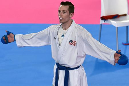 Tom Scott celebrates during the Pan-American Games Men's Under-75kg Final Karate fight against Brazil's Verissimo Hernani in Lima on Aug. 11, 2019.