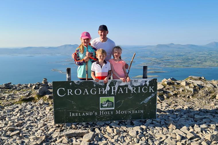 Nial McSorly and his children at the summit of The Reek in July 2021.