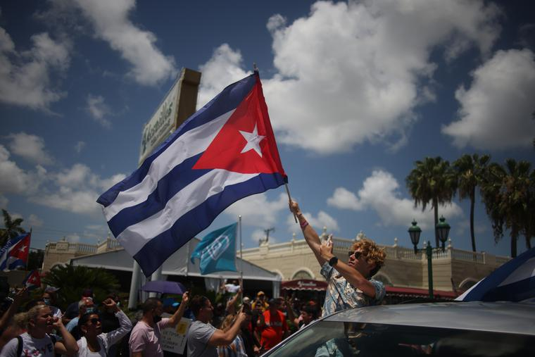 Cuban exiles rally at Versailles Restaurant in Miami's Little Havana in support of protesters in Cuba.