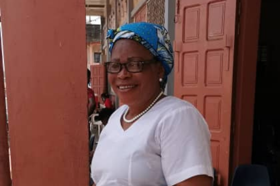 Mrs. Flora, a member of the Catholic Women's Association of Cameroon.