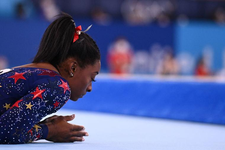 Gymnast Simone Biles prepares to compete in the floor event of the artistic gymnastic women's qualification during the Tokyo 2020 Olympic Games on July 25. Biles withdrew from Olympics all-around gymnastics on July 28.
