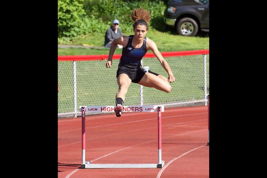 Sydney McLaughlin jumps a hurdle as a high-school athlete.