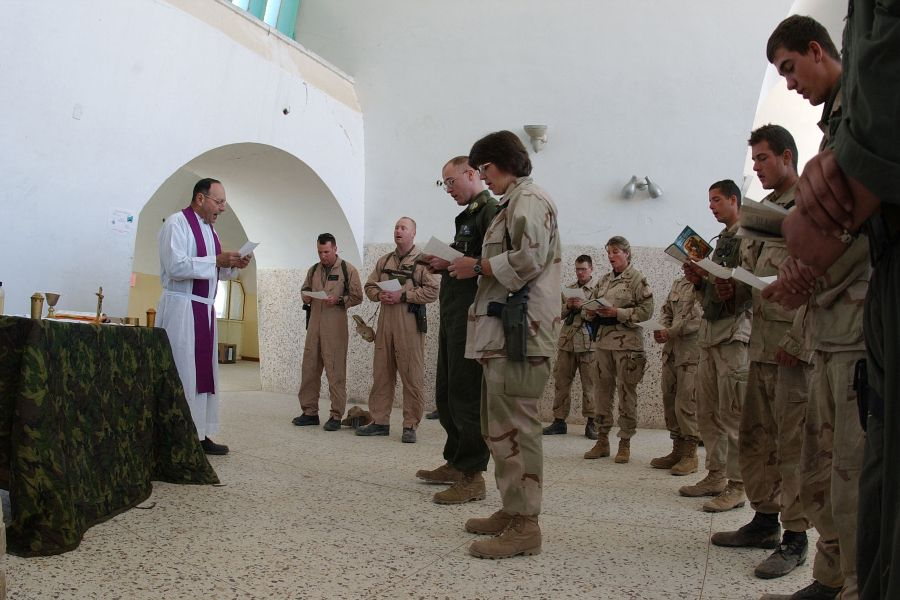 Mass for U.S. military personnel at a forward operating base in Kandahar, Afghanistan, Dec. 23, 2001.