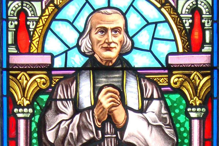St. John Vianney is depicted in a stained-glass window in Aramits, France. The window was crafted by Pierre Arcencam in 1923.