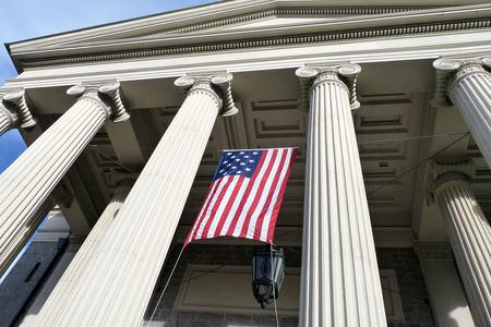 """A 15-starred """"Star-Spangled Banner"""" hangs on the facade of the historic Baltimore Basilica, the first cathedral built in the United States."""