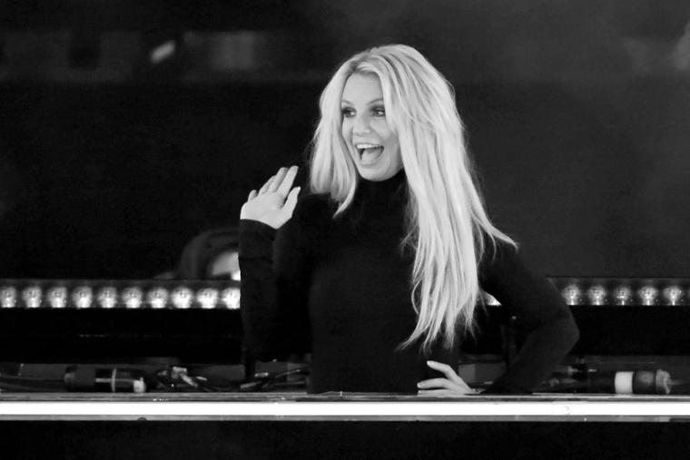 """Singer Britney Spears waves as she attends the announcement of her new residency, """"Britney: Domination"""" at Park MGM on October 18, 2018 in Las Vegas, Nevada. Spears will perform 32 shows at Park Theater at Park MGM starting in February 2019."""