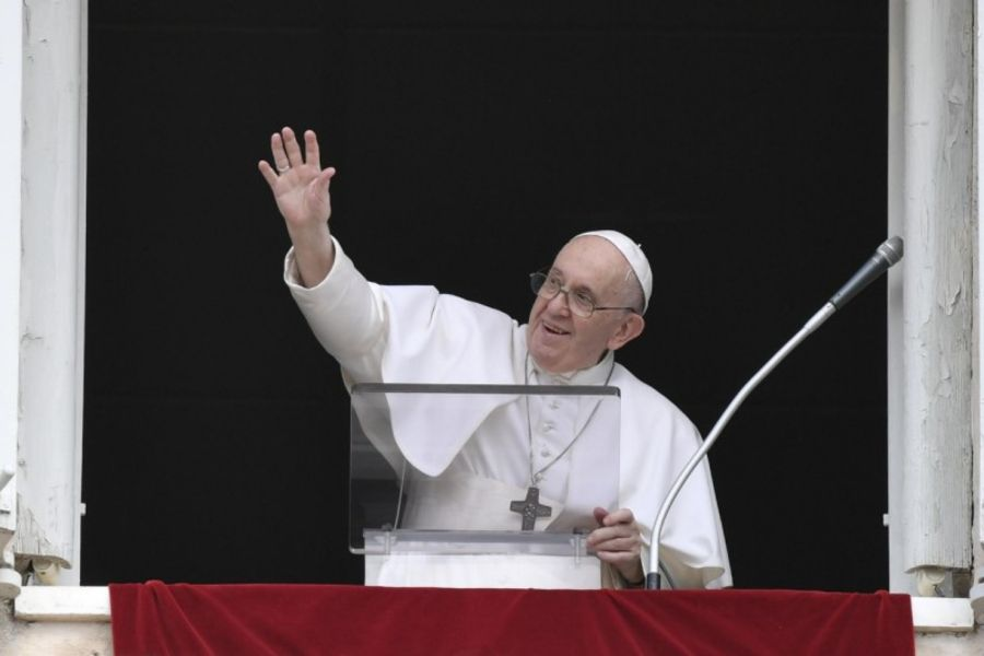 Pope Francis waves during his Angelus address at the Vatican, Aug. 8, 2021.