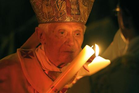 Pope Emeritus Benedict XVI lighting the Pascal Candle at the Easter Vigil Mass in St. Peter's Basilica on Saturday, April 7, 2012.