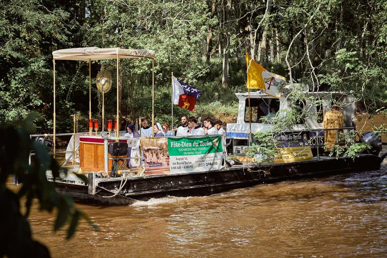 A floating 'church' carries Jesus in the Blessed Sacrament down the Bayou Teche.