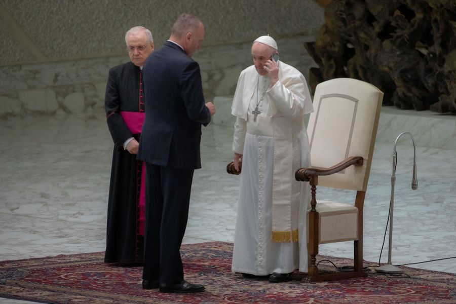 Pope Francis spoke on the phone at the end of his general audience Aug. 11, 2021.