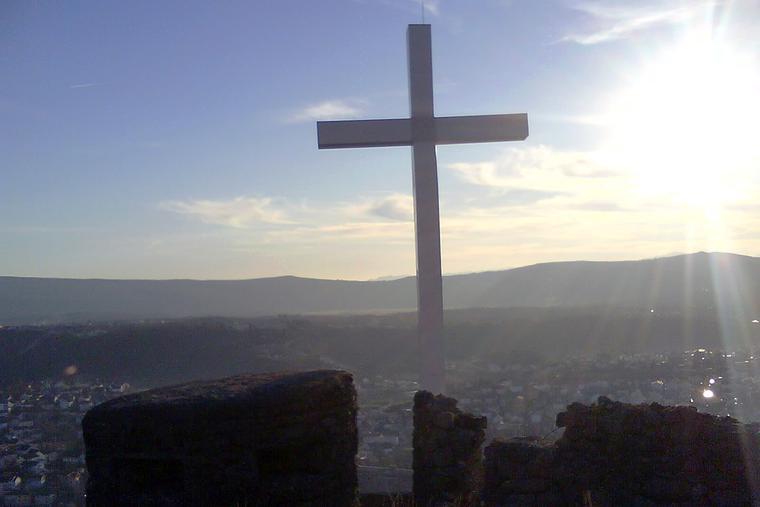 A cross stands at an abandoned Italian fort overlooking the city of Široki-Brijeg in Bosnia-Herzegovina