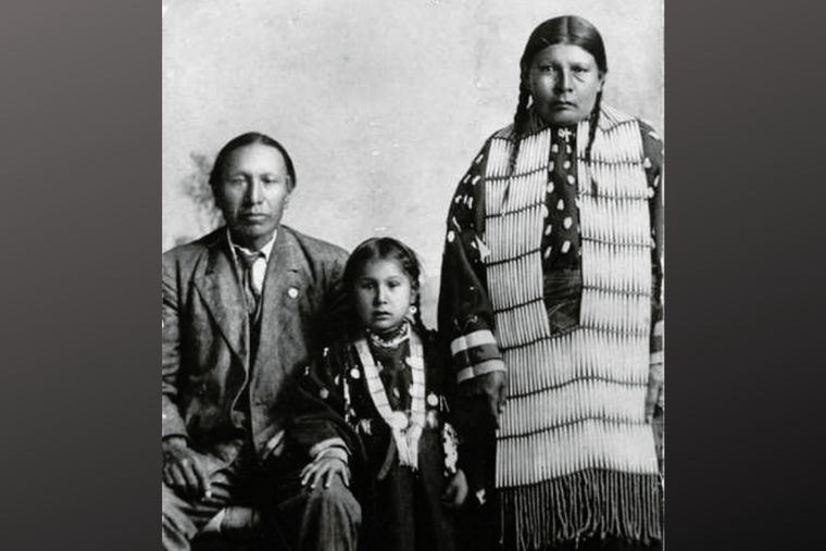 Servant of God Nicholas Black Elk, daughter Lucy Black Elk and wife Anna Brings White, photographed in their home in Manderson, South Dakota, ca 1910.