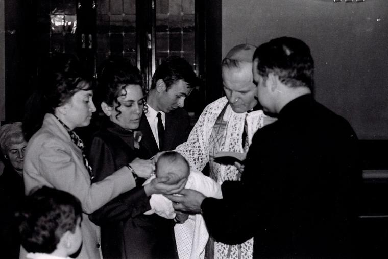 Cardinal Karol Wojtyla, the future Pope St. John Paul II, baptizes a child in a file photo from 1971.