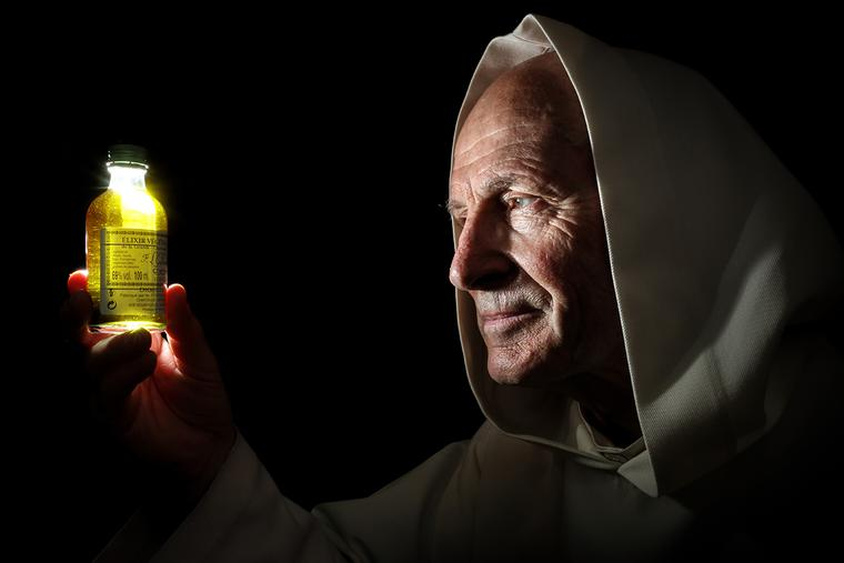 A Carthusian inspects a sample of chartreuse.