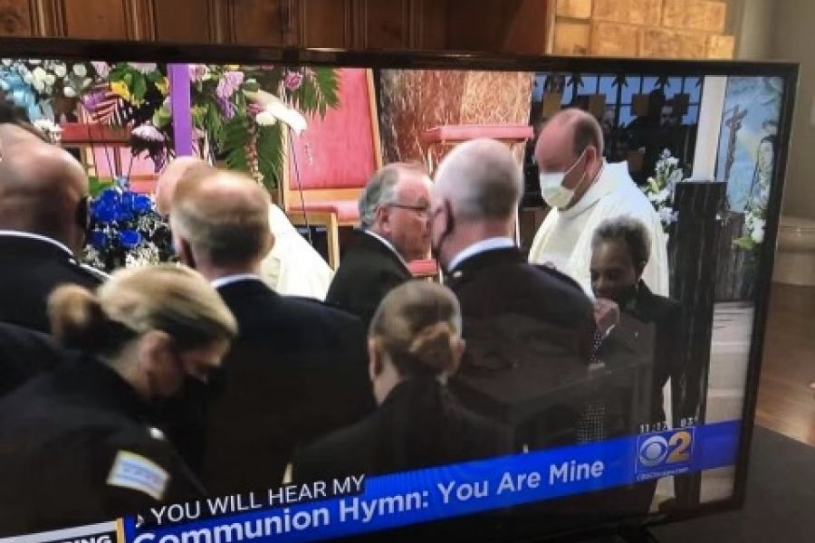 Video footage of the Aug. 19 funeral Mass for fallen Chicago police officer Ella French shows Chicago Mayor Lori Lightfoot (far right) returning from receiving Communion from Father Dan Brandt, a Catholic chaplain for the Chicago Police Department.