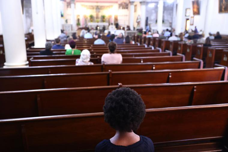 Parishioners sit during Sunday Mass at St. Augustine Catholic Church on August 15, 2021 in New Orleans, Louisiana. Parishioners wore face coverings during Mass as part of COVID-19 protocols inside the historic church which is recognized as the oldest Black Catholic parish in the country.
