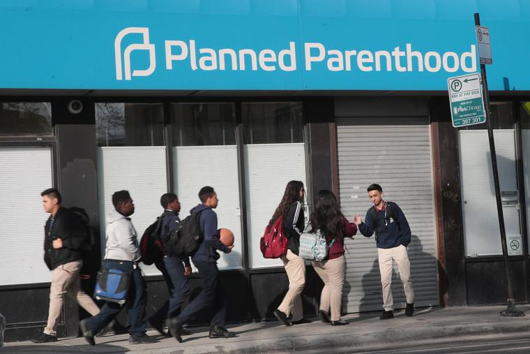 Pedestrians walk past a Planned Parenthood facility on May 18, 2018, in Chicago.
