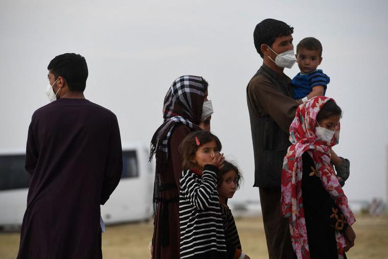 Refugees queue on the tarmac after disembarking from an evacuation flight from Kabul at the Torrejon de Ardoz air base, outside of Madrid, on Aug. 24.