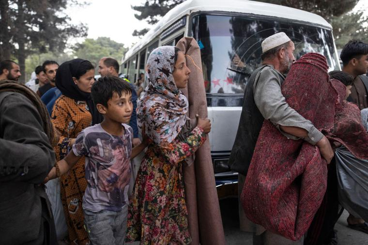 Displaced Afghans from the northern provinces are evacuated from a makeshift IDP camp in Share-e-Naw park to various mosques and schools on August 12, 2021 in Kabul, Afghanistan. People displaced by the Taliban advancing are flooding into the Kabul capital to escape the Taliban takeover of their provinces.