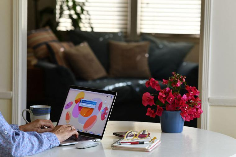 This illustration photo shows a person working on their laptop from a home office in Los Angeles on August 14, 2021. In the United States, companies are delaying one after another the return of their employees to the office, worried about the new wave of contaminations with the spread of the Delta variant.