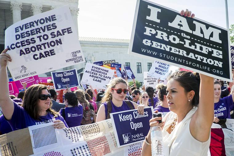 Pro-abortion and pro-life activists demonstrate on the steps of the United States Supreme Court on June 27, 2016, in Washington, DC.