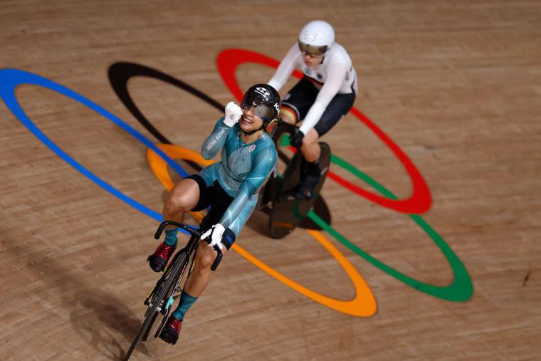 Hong Kong's Lee Wai Sze (front) celebrates after taking bronze in the women's track cycling sprint finals ahead of Germany's Emma Hinze during the Tokyo 2020 Olympic Games at Izu Velodrome in Izu, Japan, on Aug. 8.
