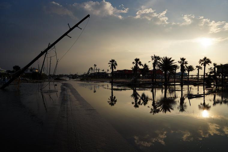 A road is partially covered in floodwater in the wake of Hurricane Ida on Sept. 3, 2021, in Grand Isle, Louisiana. Ida made landfall as a Category 4 hurricane five days before in Louisiana and brought flooding, wind damage and power outages along the Gulf Coast.