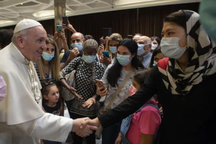 Pope Francis greets people after a documentary screening at the Vatican's Paul VI Hall on Sept. 6.