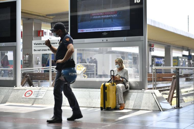 A police officer stands inside Porta Nuova Station on Sept. 1 in Turin, Italy. Italy has imposed a 'Green Pass' for the use of means of transport such as buses, trains, airplanes and ferries as of Sept. 1.