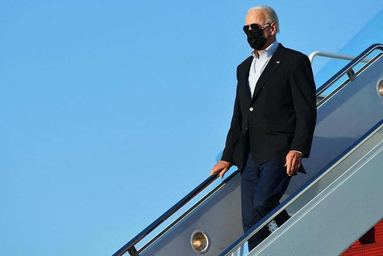 President Joe Biden steps off Air Force One upon arrival at Andrews Air Force Base in Maryland on Tuesday.