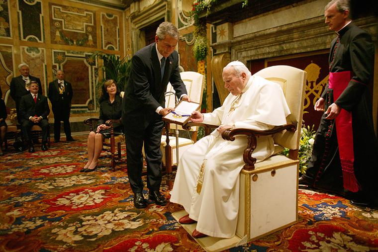 President George W. Bush presents the Medal of Freedom to Pope John Paul II June 4, 2004, during a visit to the Vatican.