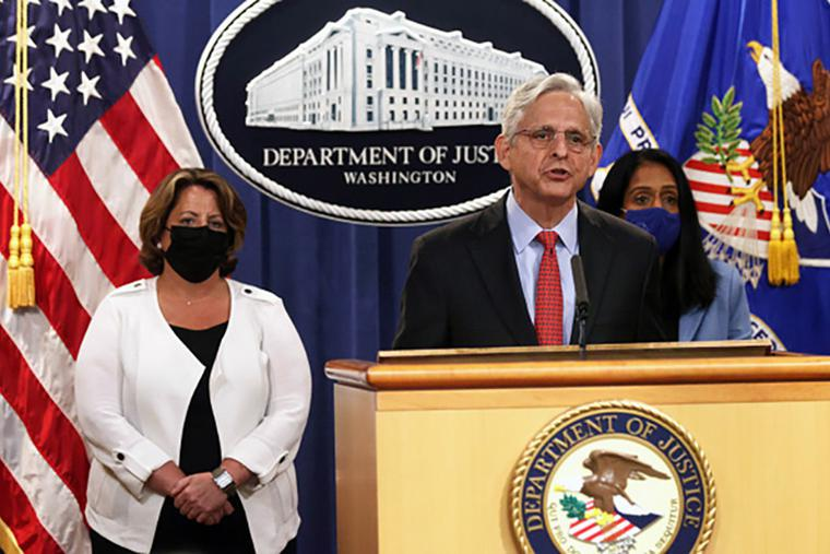 US Attorney General Merrick Garland announces the Department of Justice is filing a lawsuit against the state of Texas over the state's new law that protects unborn children from abortion after six weeks in utero, as Deputy Attorney General Lisa Monaco (L) and Associate Attorney General Vanita Gupta look on.