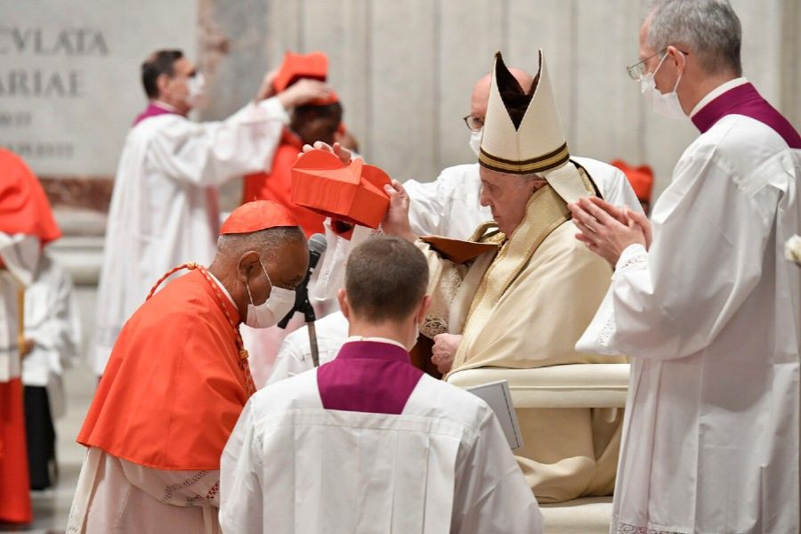 Cardinal Wilton Gregory receives his red hat from Pope Francis in St. Peter's Basilica on Nov. 28, 2020.
