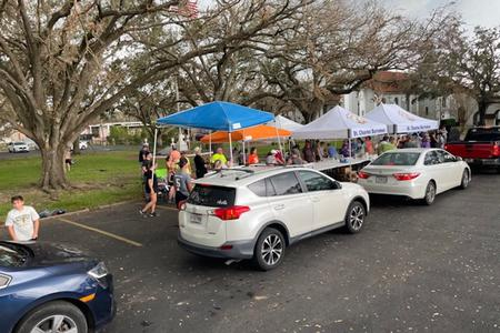 Cars line up to receive food and supplies at St. Charles Borromeo Church in Destrehan, Louisiana in the days following Hurricane Ida.