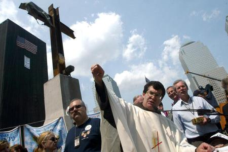 Father Brian Jordan presides over the final Sunday Mass at Ground Zero in New York, June 02, 2002. Several hundred relatives of those killed in the Sept. 11 attacks on the World Trade Center gathered for a day of interfaith services.