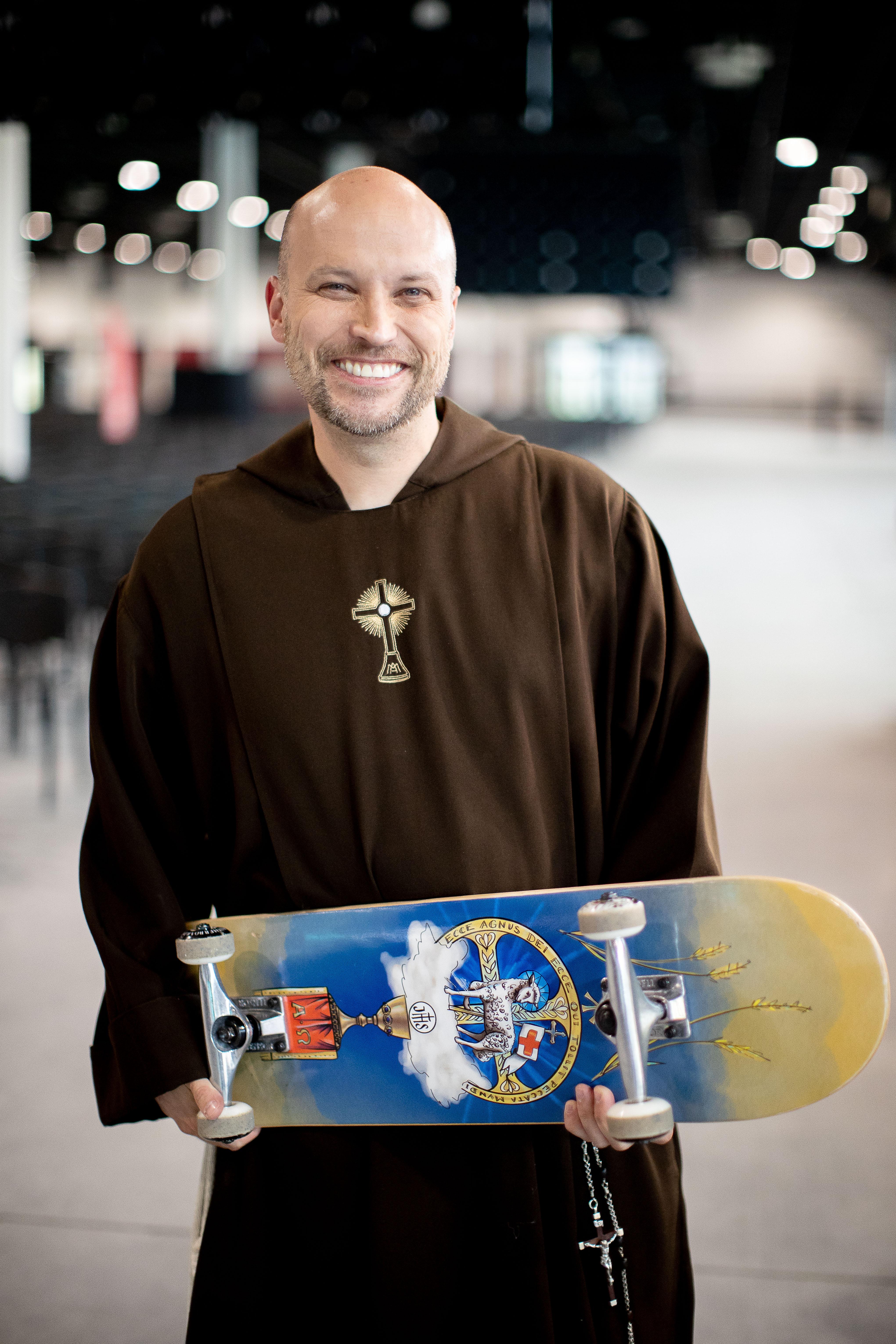 Father John Paul Zeller skates around the International Eucharistic Congress.