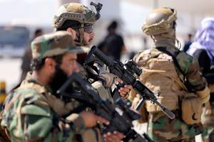 Fighters of the Taliban Badri 313 military unit stand guard at the airport in Kabul on  September 14, 2021.