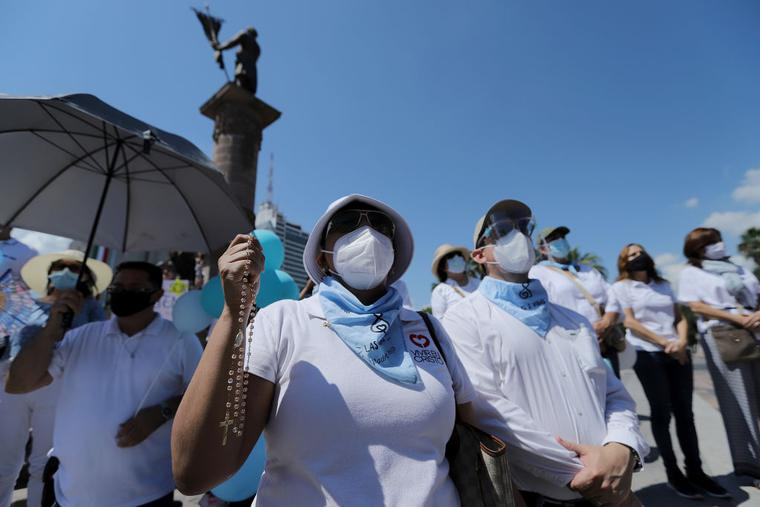 Pro-life activists shout slogans during a demonstration to protest the decriminalization of abortion at Macroplaza on September 12, 2021 in Monterrey, Mexico.