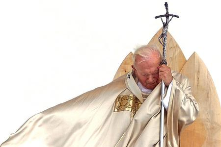 Pope John Paul II, using his crosier for support, celebrates an outdoor Mass in Slovenia, Sept. 19, 1999.