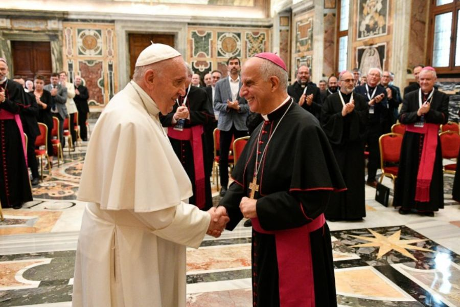 Pope Francis greets Archbishop Rino Fisichella in the Vatican's Clementine Hall, Sept. 17, 2021.