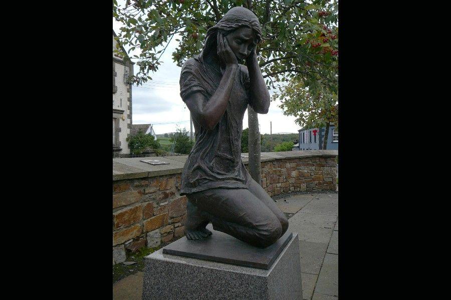Claudy bombing memorial statue created by sculptor Elizabeth McLaughlin