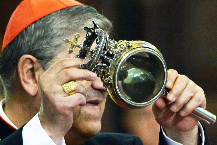 Cardinal Crescenzio Sepe displays the ampulla containing the blood of San Gennaro (St. Januarius) on March 21, 2015, in Naples.