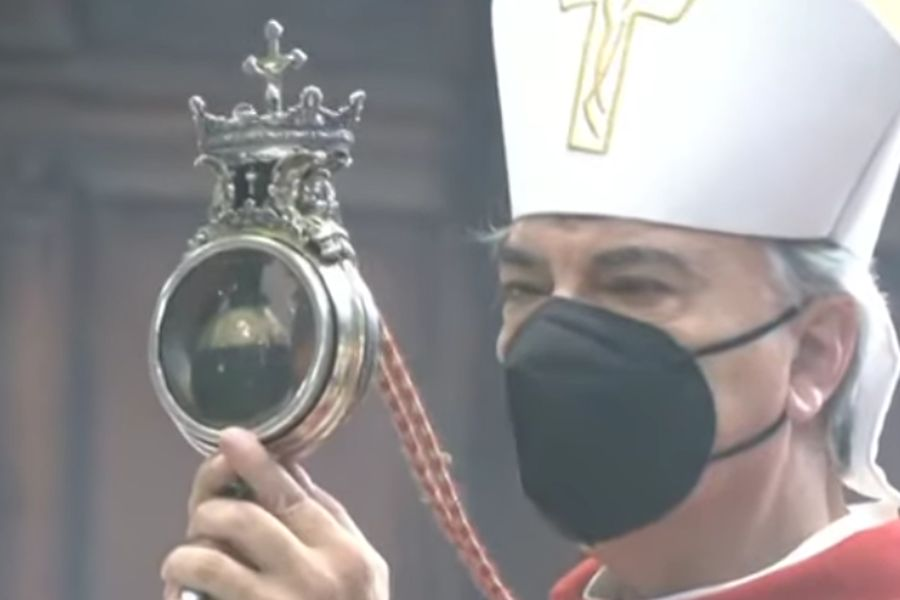 Archbishop Domenico Battaglia holds a reliquary containing St. Januarius' liquefied blood in Naples Cathedral, Italy, Sept. 19, 2021.
