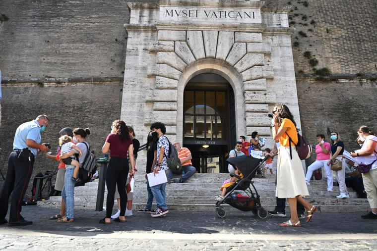 Visitors queue to show their COVID-19 certificates for scanning before entering the Vatican Museums in the Vatican on Aug. 6, as Italy made the Green Pass, which is an extension of the EU's digital COVID certificate, required to enter cinemas, museums and indoor sports venues, or eat indoors at restaurants.
