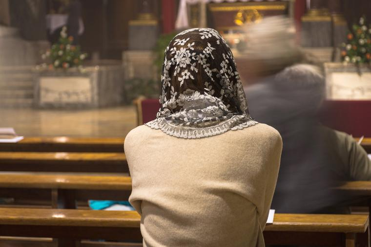 Photo illustration of a woman attending a Traditional Latin Mass.