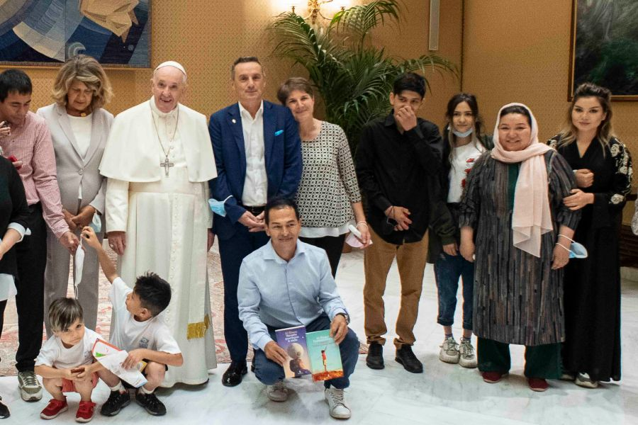 Pope Francis meets with a group of Afghan refugees at the Vatican on Sept. 22, 2021.